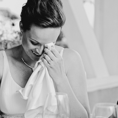 Bride wipes away tear during speeches at the Toronto Hunt Club wedding
