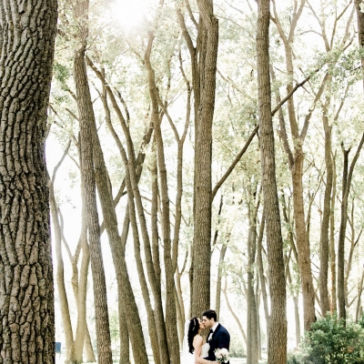 Bride and groom kissing in Cherry Beach Toronto