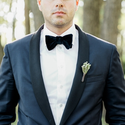 Groom looking dapper at Cherry Beach during wedding photography session