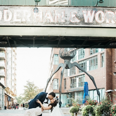 Groom dips his bride for a shot in the Distillery District Toronto