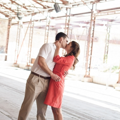 Engaged couple kissing during engagement session at Evergreen Brickworks Toronto