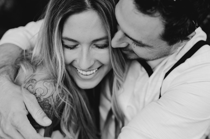 Couple hugging romantically during Engagement Session in Black & White