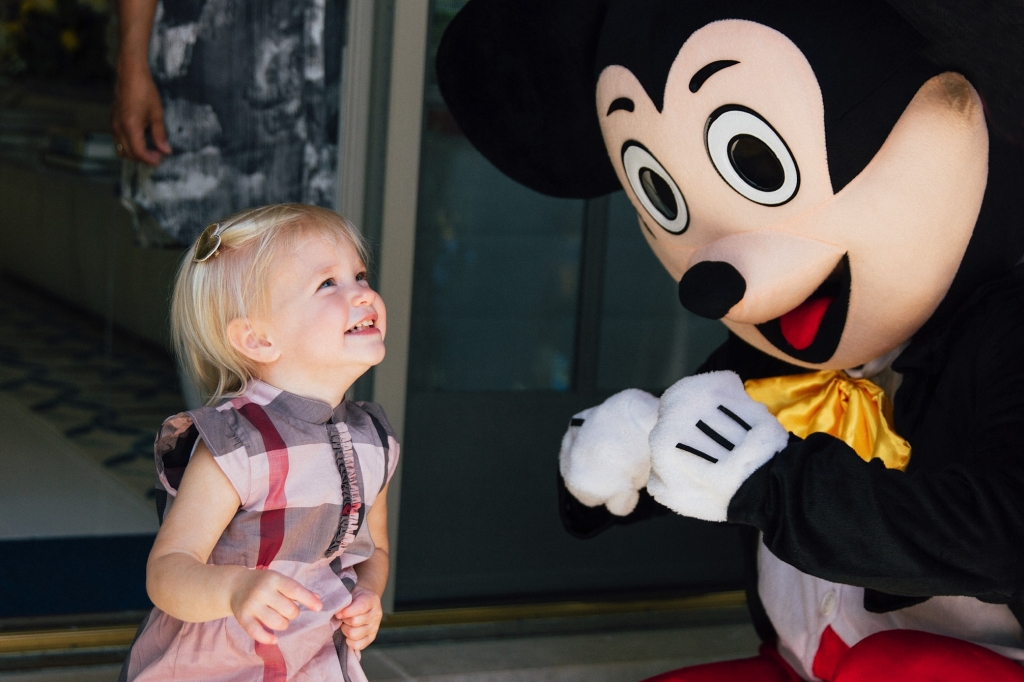 Cambridge Family Photographer Birthday girl greets Mickey Mouse