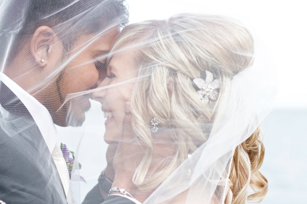 Bride and groom kissing under veil at Adamson Estates Mississauga